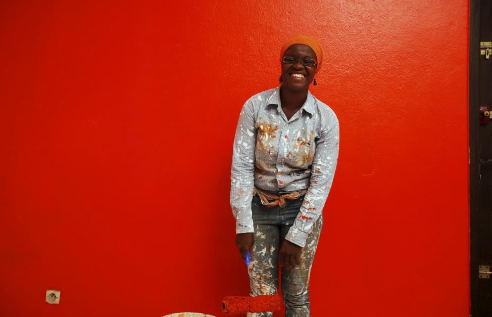 Ange Dede, a 29-year-old painter and decorator poses for a photograph in Abidjan, Ivory Coast, March 2, 2016. REUTERS/Thierry Gouegnon