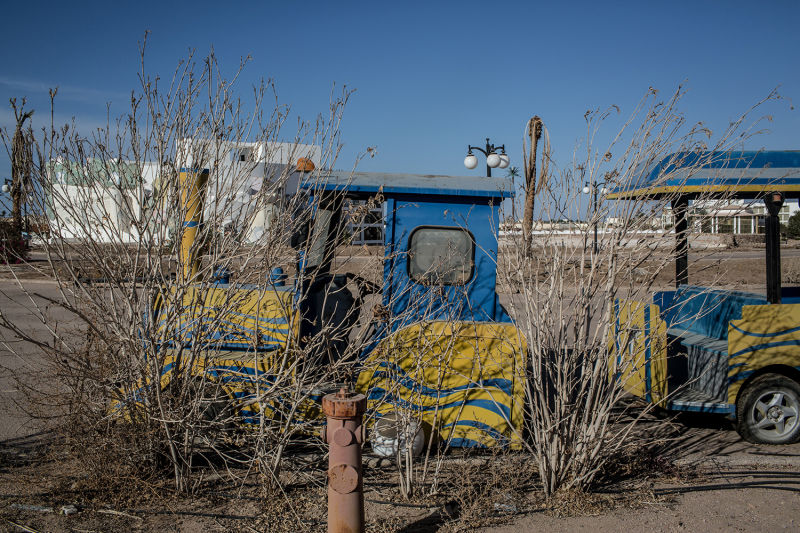 Bushes grow over a hotel novelty train cart at an abandoned hotel (Photo: Chris McGrath/Getty Images)