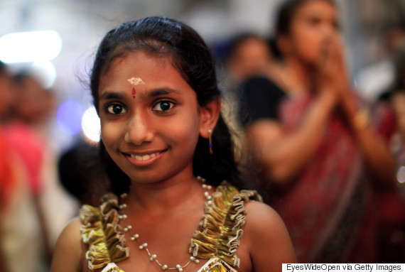 Hindu pilgrims, here a beautiful young girl with her family members or relatives visiting the Sri Krishna Temple at December 05, 2011 in Guruvayur, Kerala, India. (Photo by EyesWideOpen/Getty Images)