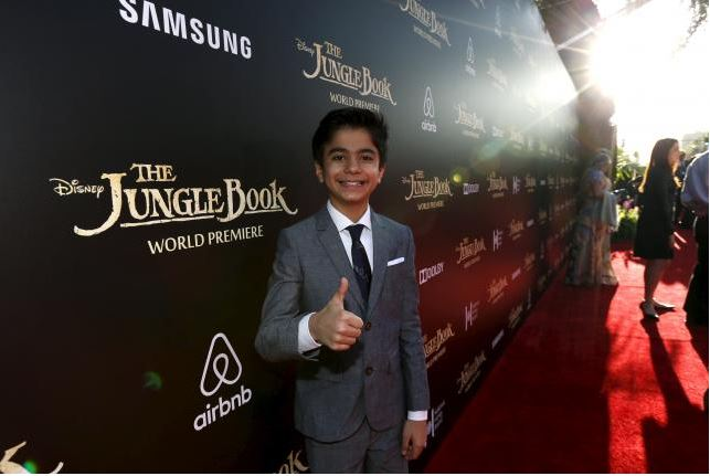 Cast member Neel Sethi poses at the premiere of 'The Jungle Book' at El Capitan theatre in Hollywood, California April 4, 2016. Reuters/Mario Anzuoni