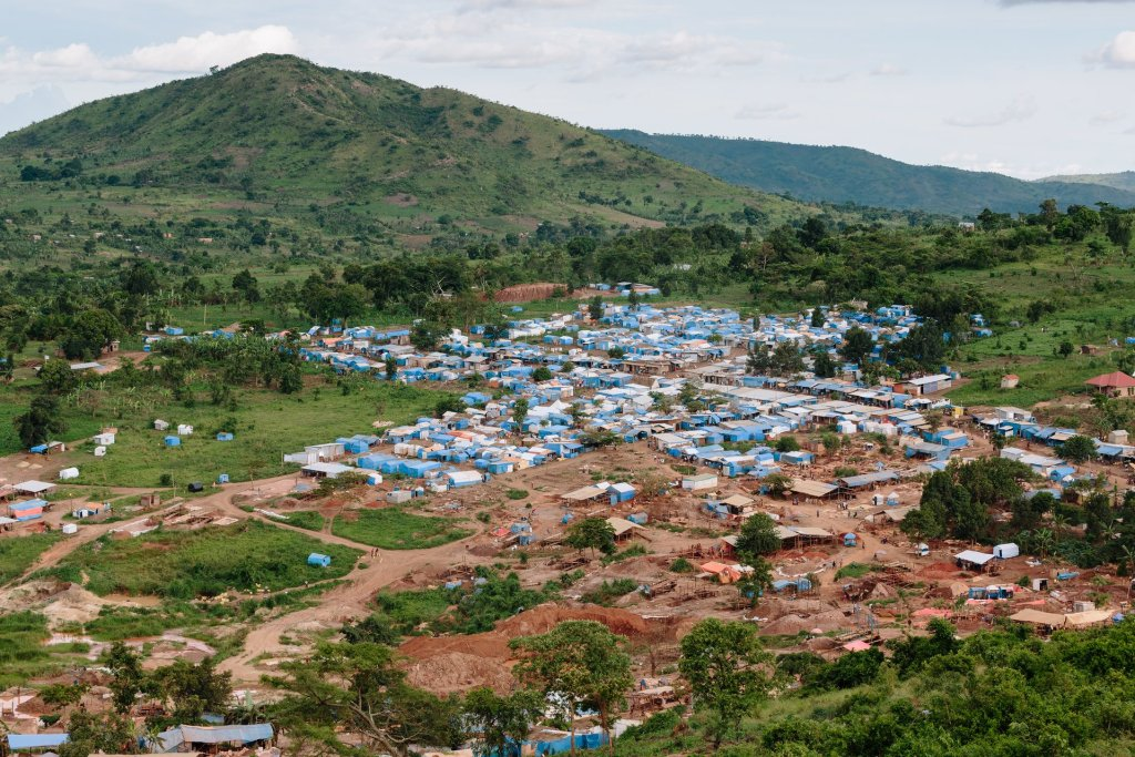 An aerial view of an artisanal mining complex in Uganda. The mining area is seen in the foreground. Photograph: Eelco Roos/Hivos