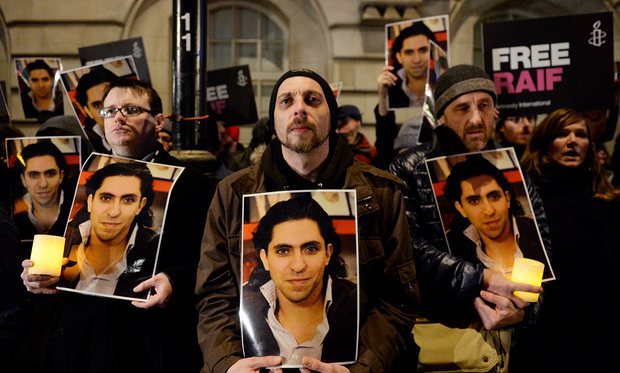 Protesters take part in an Amnesty International protest in front of the Saudi embassy in London against the flogging of Raif Badawi. Photograph: Facundo Arrizabalaga/EPA