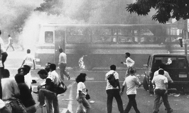 A public bus burns in Caracas during riots to protest increases in gasoline and transport fare hikes in 1989. Photograph: AP