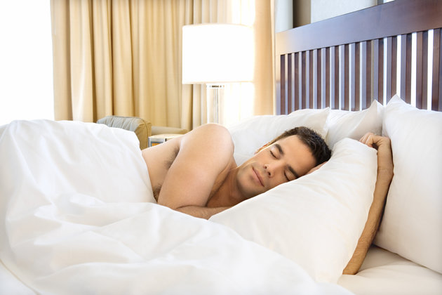 Man sleeping in hotel room