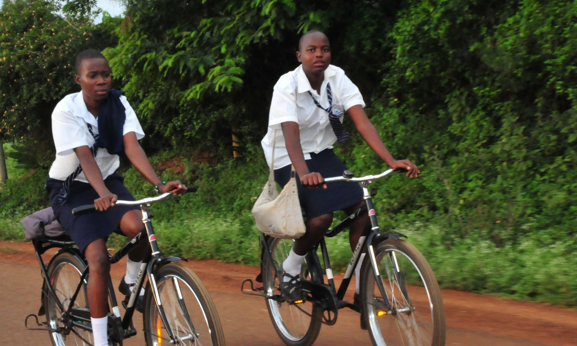 Girls pedal their Buffalos to school in Siaya county, Nyanza region. Photograph: Robert Kibet