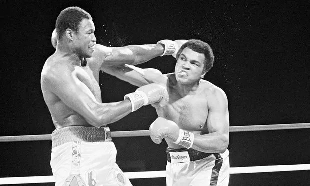 Heavyweight champion Larry Holmes and Muhammad Ali exchange blows during their world heavyweight title match in 1980. Photograph: Bettmann/CORBIS