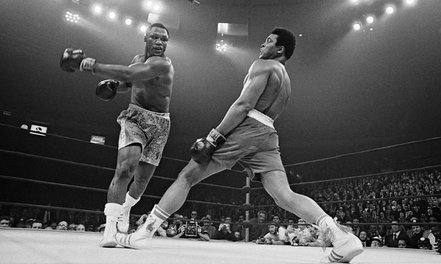 Muhammad Ali steps away from a punch thrown by boxer Joe Frazier during their heavyweight title fight at Madison Square Garden in 1971. Photograph: Bettmann/CORBIS