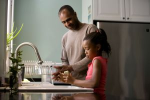 African American father was shown in the process of teaching his