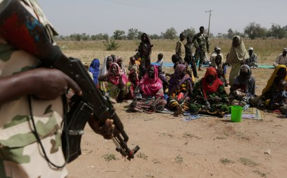 Soldiers guard Nigerians fleeing Boko Haram. In recent years northern Nigeria, Chad and Niger have suffered droughts that have fuelled political violence. Photograph: Sunday Alamba/AP