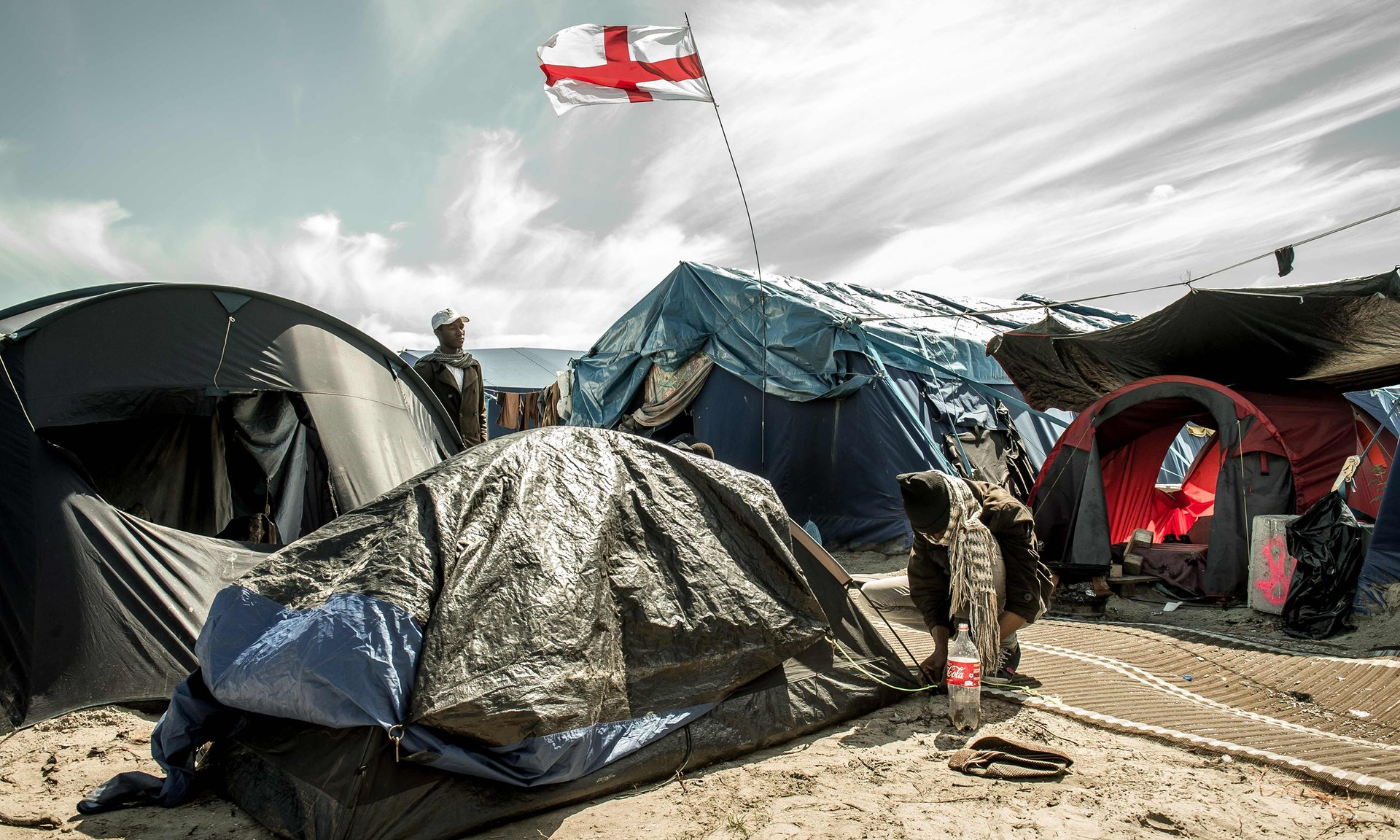 A camp for migrants and refugees in Calais. May and Hollande are in agreement that the border between France and the UK will remain in the French port Photograph: Philippe Huguen/AFP/Getty Images