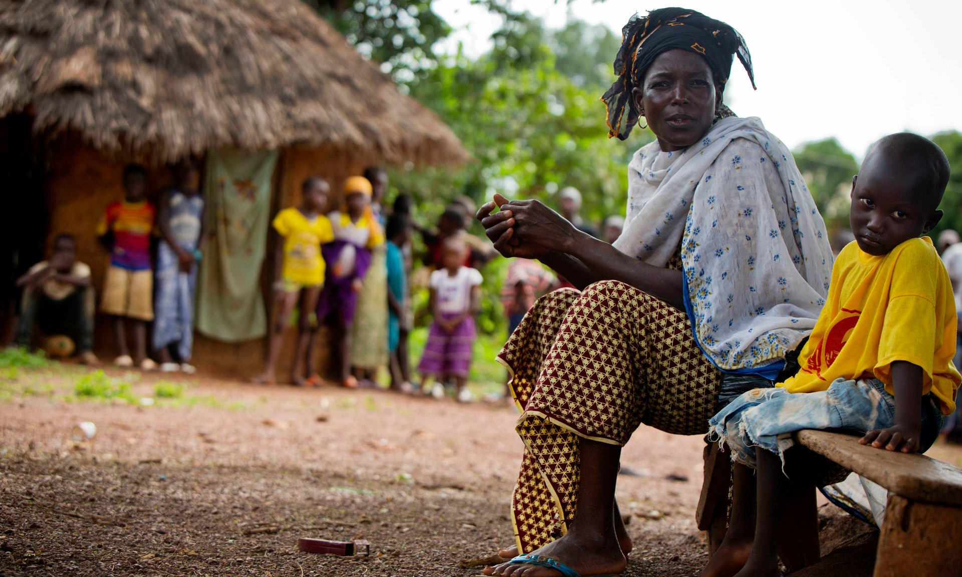 Sita Aidara sits beside her grandson, Lounceny, who contracted polio at two years old. Healthcare in Guinea was crippled by the Ebola epidemic, leaving it vulnerable to a subsequent polio outbreak. Photograph: Kate Holt/Unicef