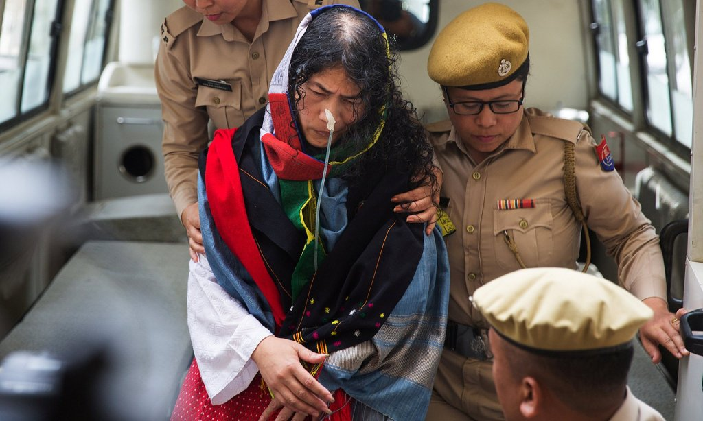 Irom Sharmila is escorted by police officers into a courtroom in Imphal. Photograph: Reuters