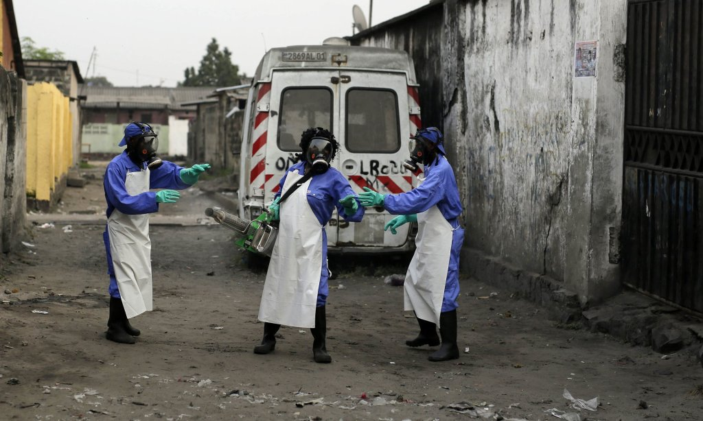 Members of a Médecins Sans Frontières team fumigate the Yolo Sud neighbourhood of Kinshasa. Photograph: Jerome Delay/AP