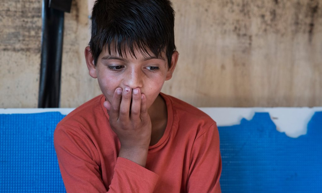 Abdul, 10, lives on his own in Calais, where he looks after his nine-year-old nephew as they try to get to the UK. Photograph: Alecsandra Raluca Drăgoi for the Guardian