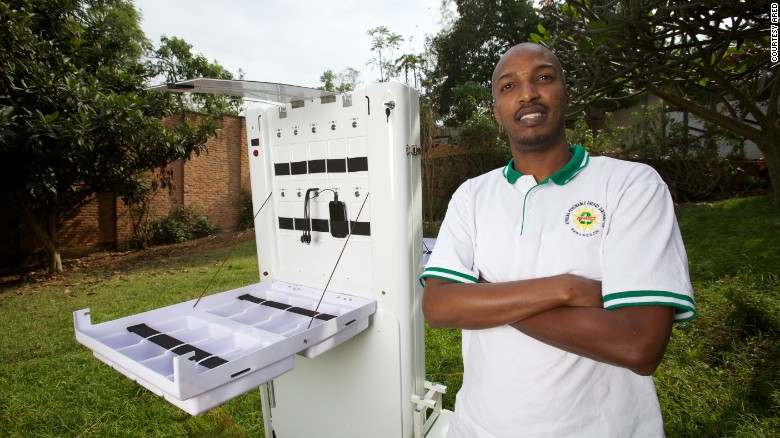 Photos: Africa's Solar Start-ups Power of the sun - Solar energy innovator Henri Nyakarundi with his portable mobile charging kiosk in Rwanda.