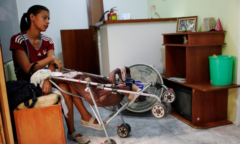 Geraldine Rocca, 29, waits for the results of a pregnancy test before her sterilization surgery in Caracas, Venezuela. Photograph: Carlos Garcia Rawlins/Reuters