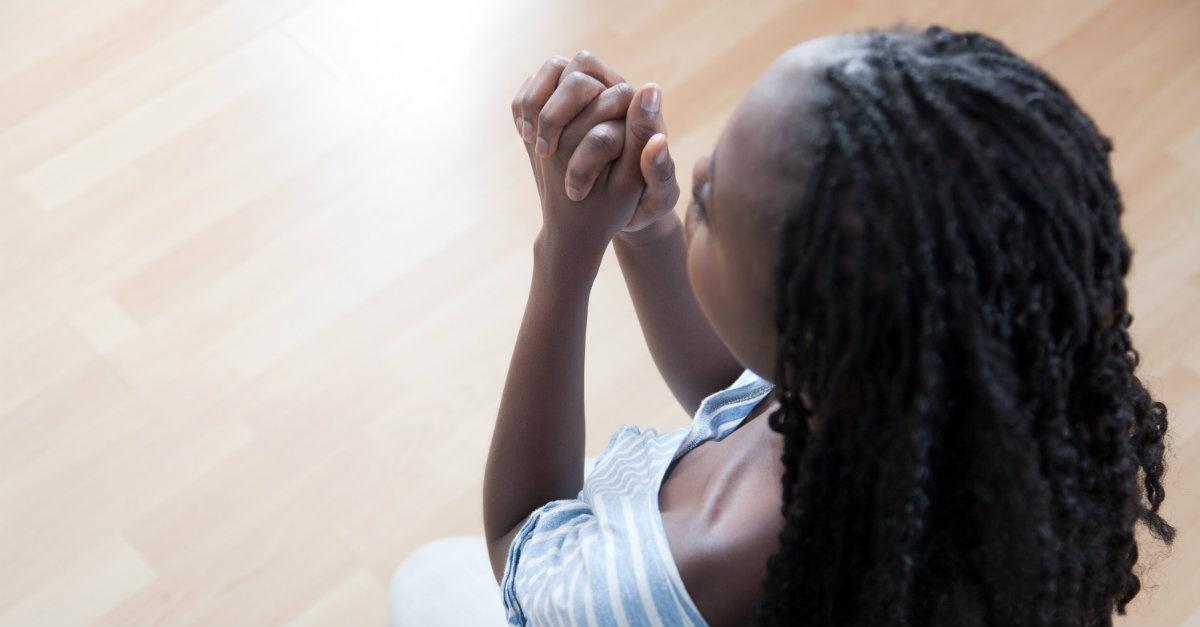 praying-on-knees-woman