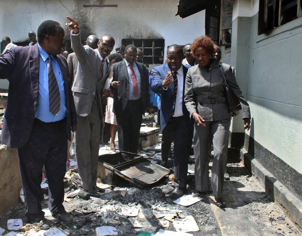 Kenyan education secretary Fred Matiangi inspects a building destroyed by fire at Itierio boys' high school in Kisii county. Photograph: AFP/Getty Images