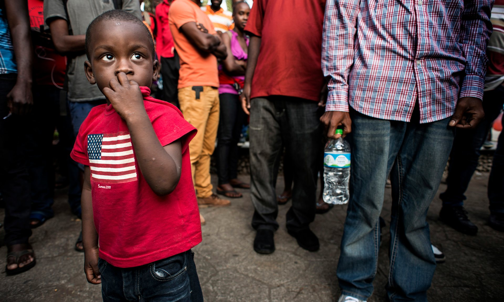 A child waits in front of the immigration center in Tapachula for an exit permit to the US. Photograph: Encarni Pindado for the Guardian