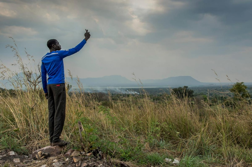 A young South Sudanese refugee tries to get a signal on his mobile phone in Nyumanzi refugee settlement, Adjumani, northern Uganda, in this 2014 file photo. © UNHCR/ Frederic Noy