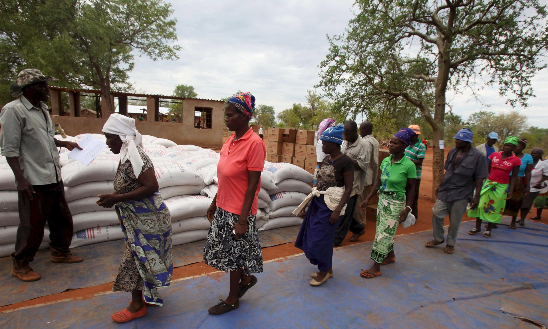Villagers in Masvingo collect monthly rations provided by the World Food Programme. Drought has created a major food crisis in Zimbabwe. Photograph: Philimon Bulawayo / Reuters/Reuters