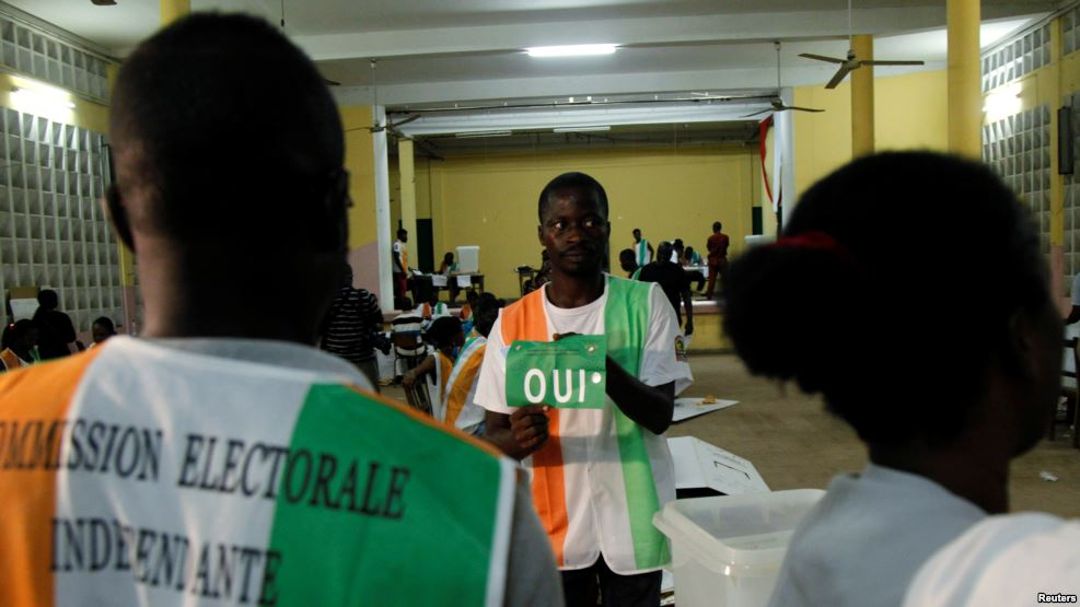 FILE - A polling official counts ballots at a polling station during the referendum for a new constitution, in Abidjan, Ivory Coast, Oct. 30, 2016.