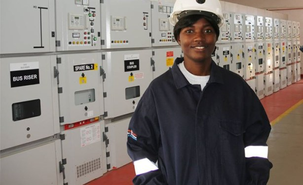 Photo: IEEE Likonge Makai Mulenga in front a substation she worked on.