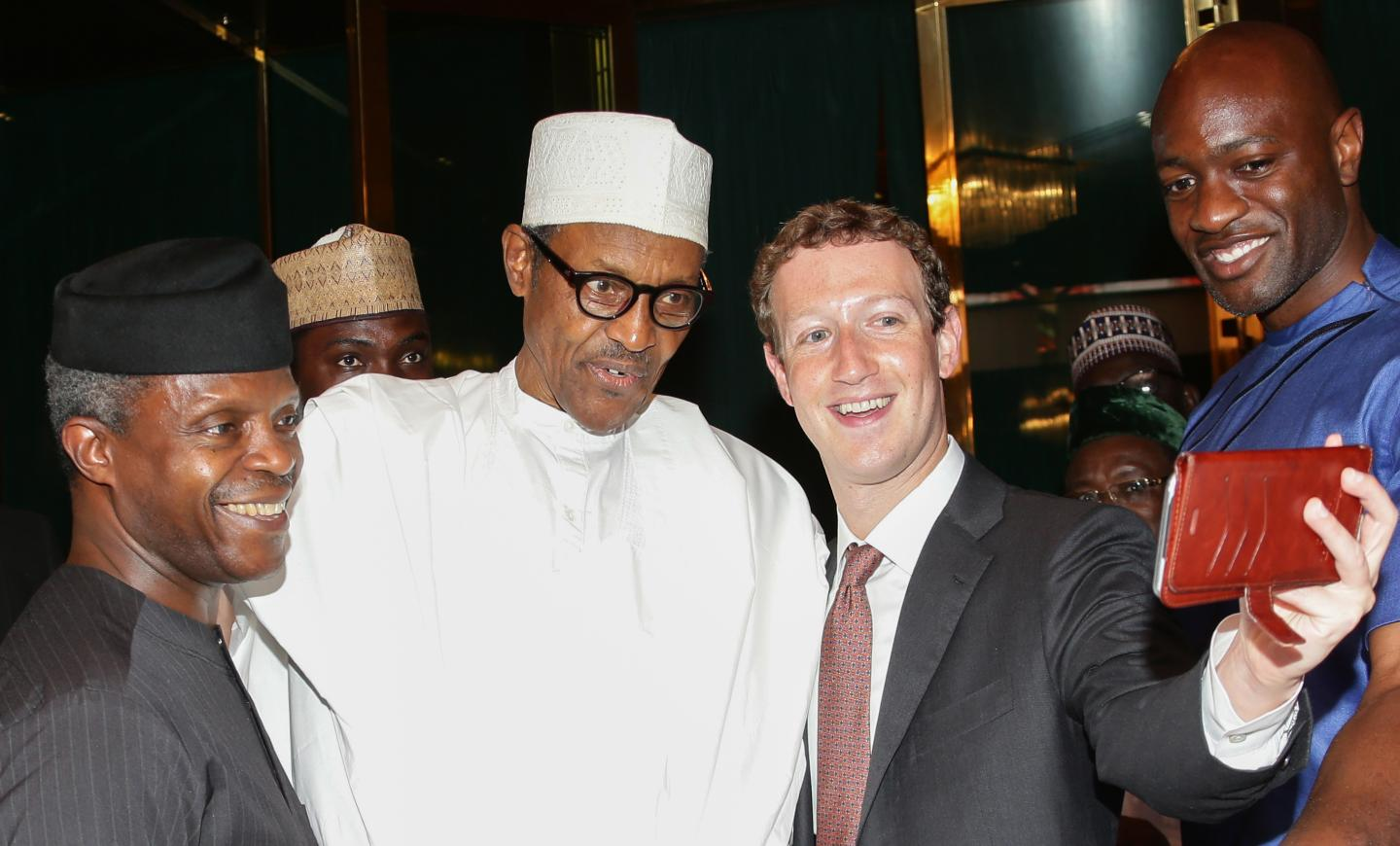 Facebook founder Mark Zuckerberg takes a selfie with Nigerian President Muhammadu Buhari (center) and Vice-President Yemi Osinbajo during a visit to the presidential palace in Abuja, Nigeria, on September 2. Zuckerberg was full of praise for Nigeria's technology sector during his surprise visit. SUNDAY AGHAEZE/AFP/GETTY