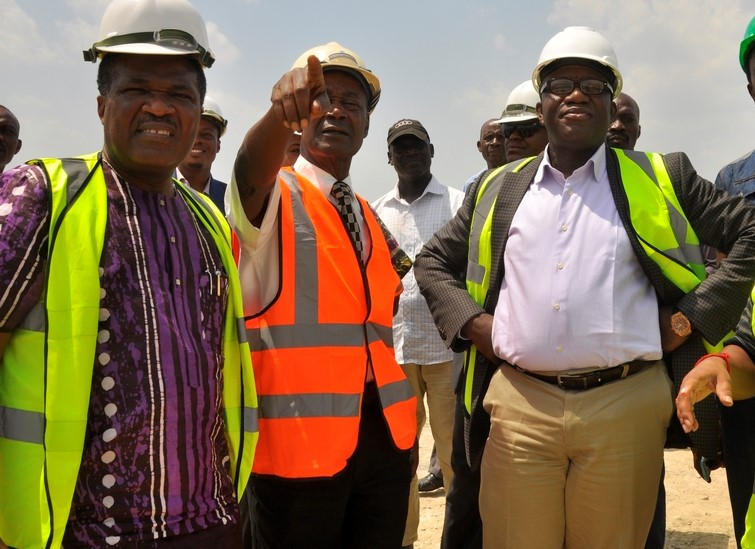 L-R; Ogun State Commissioner for Commerce and industry, Otunba Bimbo Ashiru; Special Adviser to Presdent/CEO Dangote Group, Engr Joseph Makoju and Minister of mines and Steel Development, Dr Kayode Fayemi; during the Minister's tour of the Dangote Cement's limestone mining site in Ibese, Ogun State