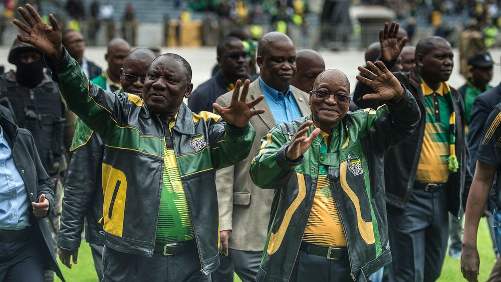 South African President Jacob Zuma (right) and ANC deputy President Cyril Ramaphosa arrive at Orlando Stadium in Soweto on Jan. 8, 2017. Photographer: MUJAHID SAFODIEN/AFP/Getty Images