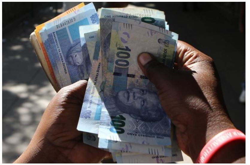 Reuters Staff  2 Min Read  A street money changer counts South African Rands in Harare, Zimbabwe, May 5, 2016.