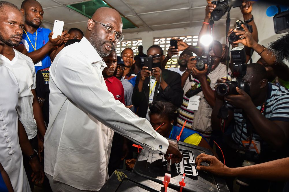 George Weah casts his vote for Liberia's elections, at a polling station in Monrovia on Oct. 10, 2017. Photographer: Issouf Sanogo/AFP via Getty Images