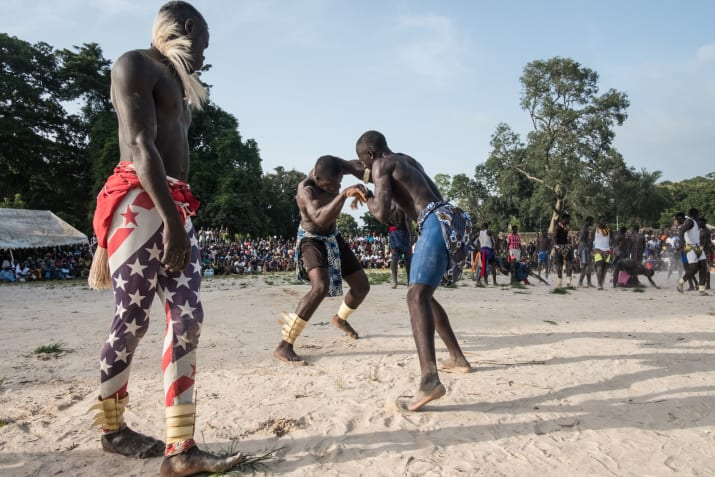 Young men compete in traditional wrestling before the women take the sandy ring at the Festival of the King of Oussouye. Photo: Ricci Shryock for Buzzfeed News