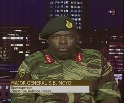 In this image made from video, Major Gen. S.B. Moyo addresses to the nation in Harare on Nov. 15. Photographer: ZBC via AP Photo