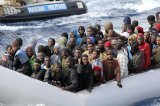 Scores Of Migrants Flee After Being Rescued Off Libyan Coast