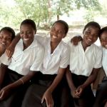 Rehema, right and friends at school all on KIND scholarships. Photo: UNICEF USA