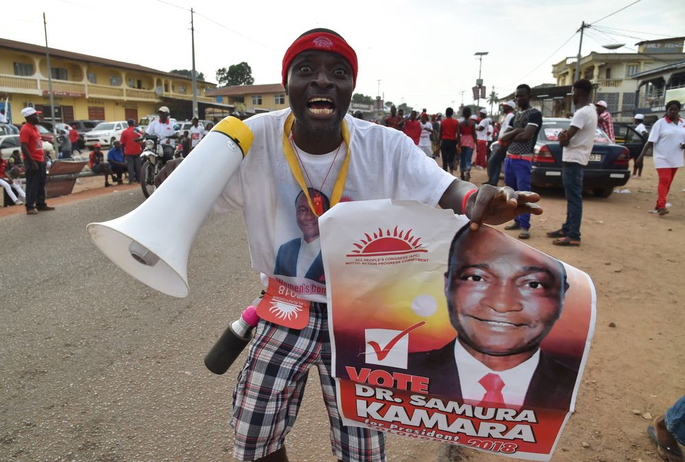 A supporter of Sierra Leone's All People's Congress presidential candidate Samura Kamara cheers during a campaign rally on March 5.  Photographer: Issouf Sanogo/AFP via Getty Images