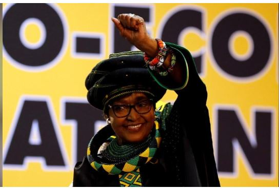 Winnie Madikizela Mandela, ex-wife of former South African president Nelson Mandela, gestures to supporters at the 54th National Conference of the ruling African National Congress (ANC) at the Nasrec Expo Centre in Johannesburg, South Africa December 16, 2017. REUTERS/Siphiwe Sibeko