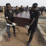 Pall bearers during the funeral service for people killed during cattle herder-farmer clashes in January 2018. Photographer: Pius Utomi Ekpei/AFP via Getty Images