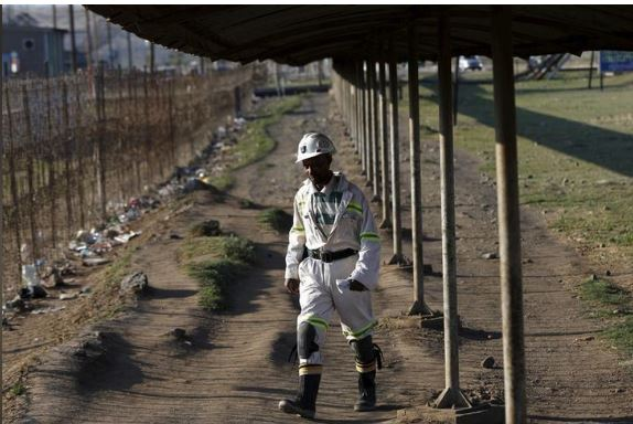 FILE PHOTO: A mine worker returns from the Lonmin mine at the end of his shift, outside Rustenburg, northwest of Johannesburg October 5, 2015. REUTERS/Siphiwe Sibeko