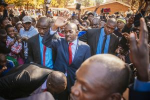 Nelson Chamisa waves to supporters as he arrives to cast his vote on July 30. Photographer: Waldo Swiegers/Bloomberg