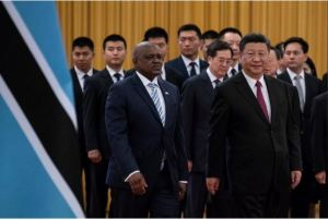 China's President Xi Jinping (R) and President of Botswana Mokgweetsi Masisi arrive for the welcome ceremony at the Great Hall of the People in Beijing, China, 31 August 2018 Roman Pilipey/Reuters