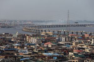 Traffic passes across a bridge from Isale Eko on Lagos Island towards the mainland in Lagos, Nigeria. Photographer: George Osodi/Bloomberg