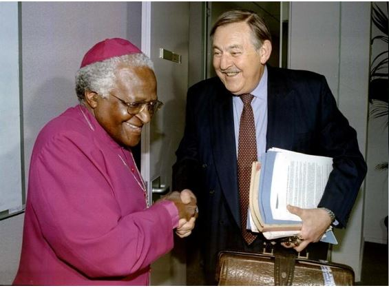 Former South African Foreign Minister Pik Botha shakes hands with Archbishop Desmond Tutu at the Truth and Reconciliation Commission (TRC) in Johannesburg, South Africa, October 14,1997. REUTERS/Juda Ngwenya/File Photo