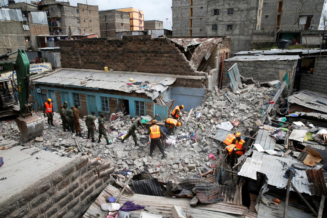 Rescue workers search the rubble of a collapsed five-storey building where at least three people have been confirmed dead and several are feared trapped inside, in a residential area of Nairobi, Kenya, June 3, 2018. REUTERS/Baz Ratner