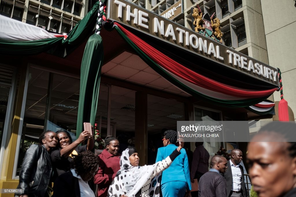 People take selfies at the entrance of Kenya's National Treasury building after the Cabinet Secretary for National Tresury left with the budget briefcase for Parliament to read the budget speech for 2018-2019 in Nairobi, Kenya, on June 14, 2018. (Photo by Yasuyoshi CHIBA / AFP)        (Photo credit should read YASUYOSHI CHIBA/AFP/Getty Images)