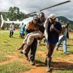 A wounded survivor is evacuated by helicopter from Chimanimani on March 19, 2019 to an hospital in Mutare, after the area was hit by the Cyclone Idai. - More than a thousand people are feared to have died in Mozambique alone while scores have been killed and more than 200 are missing in neighbouring Zimbabwe following the deadliest cyclone to hit southern Africa. Cyclone Idai tore into the centre of Mozambique on March 14 night before barreling on to neighbouring Zimbabwe, bringing flash floods and ferocious winds, and washing away roads and houses. (Photo by ZINYANGE AUNTONY / AFP)        (Photo credit should read ZINYANGE AUNTONY/AFP/Getty Images)