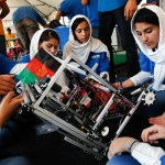 Lida Azizi, right, and other members of the Afghanistan team repair their robot during the competition.