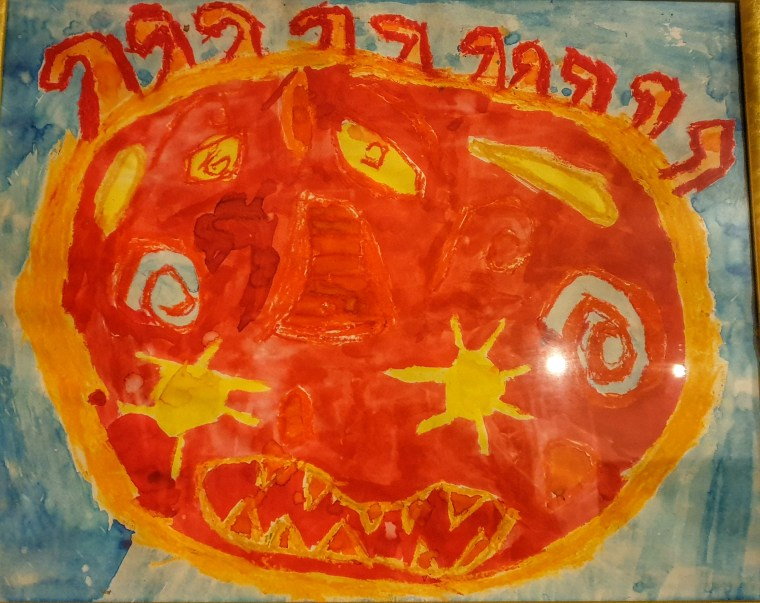 childs painting of a big orange sun with a face