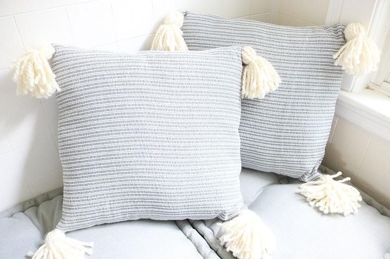 farmhouse tassel pillow covers a box